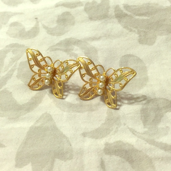 db07be4db Gold and pearl butterfly earrings (studs). M_5b68f44bf63eea4dc94fe459.  M_5b68f44bf63eea4dc94fe459